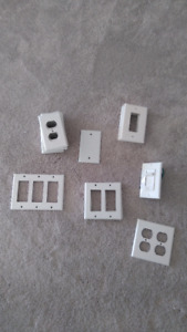 27 switch/prong plates and one dimmer switch