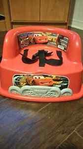 """Cars"" booster seat and green booster seat"