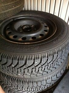 Selling 4 215/65/16 goodyear directional snow tires