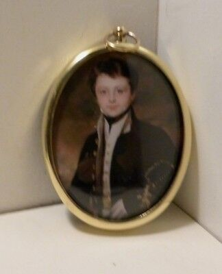 Portrait miniature of midshipman in an oval brass frame
