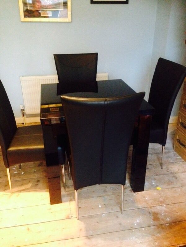 Next high gloss black square dining table and four faux leather