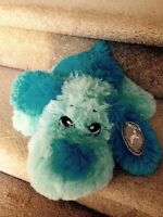 Stuffy blue dog with tag