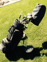 Golf clubs with bag and cart
