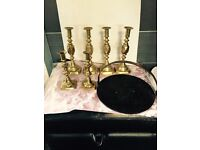 Three sets of brass candle sticks plus griddle