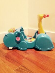 Fisher price gobble and go hippo