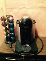 Nespresso vertuolline coffee maker with coffee and stand