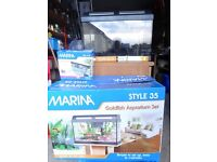 Marina 35l fish tank. 48cm x 25cm x 30cm deep.