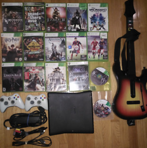 Xbox 360s Bundle with 16 games and wireless guitar