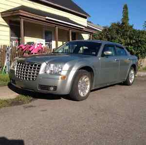2006 chrysler300 nice car works great!! Trade for truck