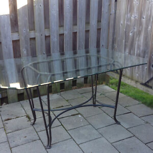 Glass top wrought iron table