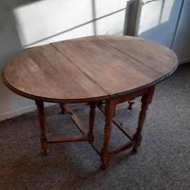 Charming Rustic Round Wooden Folding Dining Drop Leaf Table