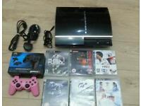 Play station 3 complete console with games and manual booklet