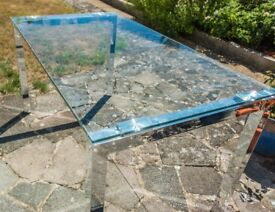 Beautiful large glass-top dining table, polished chrome legs. Seats 6.