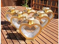 Six heart shaped tea light holders