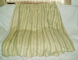 Curtains – a pair of thermal lined curtains with tie backs.