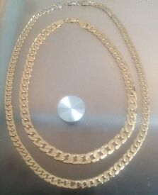 2 gold colour chains