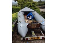 Zodiac inflatable boat and road trailer