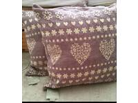 Two brand new large cushions with tags.