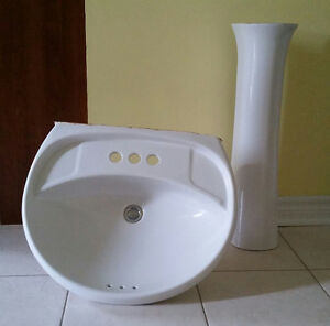 Pedestal sink and Moen faucet