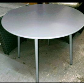 A new stylish grey mettle round garden table