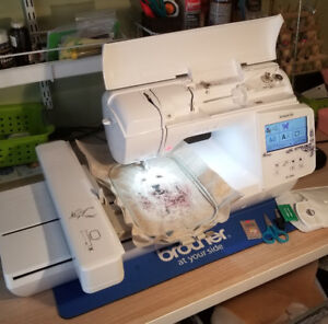 Brother 16000E embroidery machine almost new still has warranty