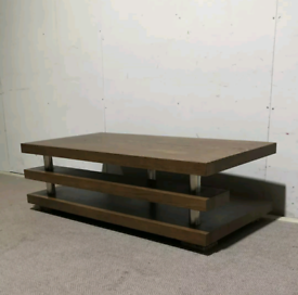 Large dark oak coffee table with a shelf underneath the table top