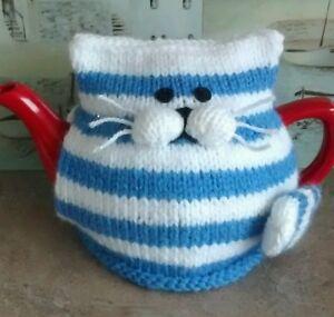 Hand-knitted Cornishware cat tea cosy.