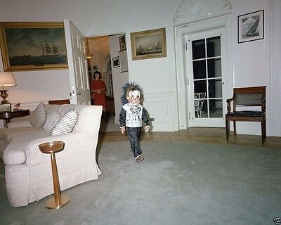 John F. Kennedy Jr. wearing a Halloween mask in the Oval Office New 8x10 Photo - John F Kennedy Halloween