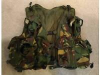 Camouflage multi pocket woodland vest.