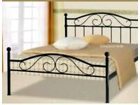 Black double bed with mattress