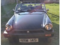 MG Midget 1500 Black convertible. nice solid car ready for the summer