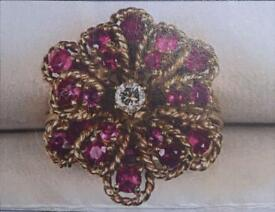 Ruby ring with centre diamond
