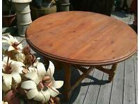 Folding circular pine table , solid