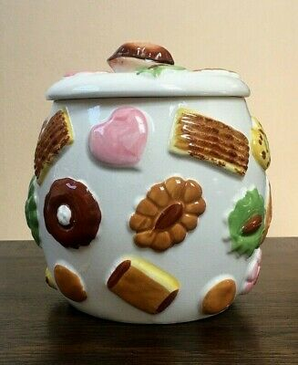 VINTAGE COOKIE JAR W/COOKIES ALL OVER & A WALNUT HANDLE ON LID