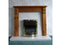 Pine fire surround with marble hearth and electric fire