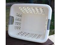 White and yellow rectangular washing baskets