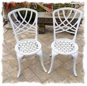 631: Pair Of White Cast Iron Chairs