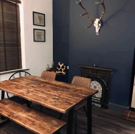 Bespoke reclaimed wood dining table and matching benches