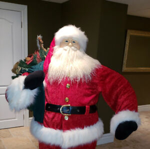 $150 - Life Size Santa Claus with gift sac (retails for $450)