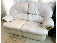 Reclining two seat sofa, cream.