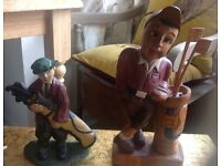 GOLF MAN CARVED IN WOOD,AND A GOLFER IN IRON . UNUSUAL ,CAN PUT IN HOUSE OR GARDEN ,QUITE FUN THINGS