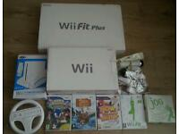 Nintendo Wii console with 4 games Nintendo Wii Fit board Nintendo Wii wheel Nintendo Wii stand