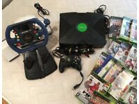 Xbox with games and steering wheel