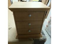 A brand new stylish 3 drawer bedside table.