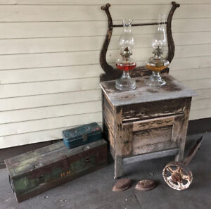 Antique lot - wash stand, WWII ammo, fishing box, irons, lamps