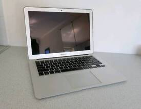 Apple MacBook Air with charger and case