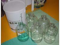 5 clear wine demijohns plus fermentation bucket