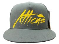Grey Atticus Baseball Cap with yellow logo. New in packaging.
