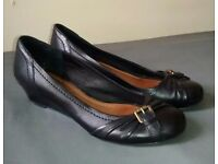 Black leather wedges with buckle detail from Aldo size 40