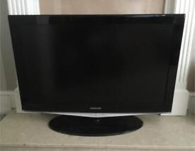 "40"" black Samsung TV"